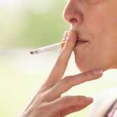Woman with Cigarette Exhaling Smoke. — Stock Photo