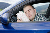 Exhausted man is sleeping in a car. — Stock Photo
