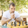 Stock Photo: Portrait of pensive mchess opponent.