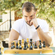 Man plays chess. — Stock Photo