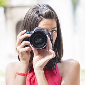 Photographer using professional camera. — Stock Photo