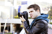 Photographer using camera in public space. — Stock Photo