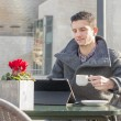 Man with coffee cup laptop computer in the terrace restaurant. — Stock Photo