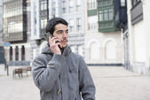 Man talking by phone in the street. — Stock Photo