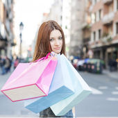 Attractive young woman with shopping bags in the street. — ストック写真