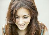 Closeup portrait of smiling beautiful woman looking down. — Stock Photo