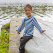 Boy and boat — Stock Photo
