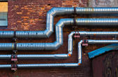 Pipes on the wall — Stockfoto