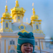 Little boy walking in a winter Peterhof — Stock Photo