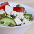 Low-calorie salad with fresh vegetables and cheese — Stockfoto