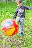 European boy playing with a ball — Stock Photo