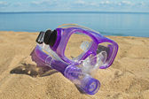 Scuba mask on the sand — Stok fotoğraf