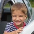 Child playing behind the wheel of a car — Foto Stock