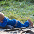 Little boy lying on green grass — Stock Photo