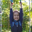 Boy hanging on the rings — Stock Photo #29024623
