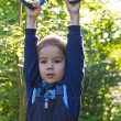 Boy hanging on the rings — Stock Photo