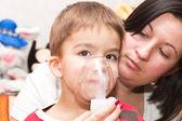 Child and inhaler — Stock Photo