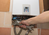 Repair of the gas water heater — Stock Photo