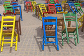 Street cafe chairs tables colors — Stock Photo