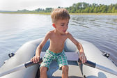 Child in an inflatable boat for rowing — ストック写真