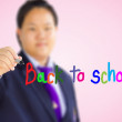 Students in uniform is writing back to school. — Stock Photo
