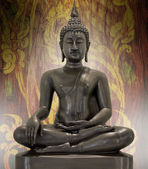 Buddha statue on a grunge background. — Stock Photo