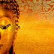 Buddha gold statue on golden background . - Stok fotoraf