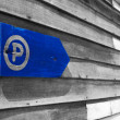 Royalty-Free Stock Photo: Parking sign on the old wooden wall.