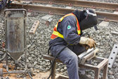 Workers repair the railway tracks with Sandblasted. — Stock Photo