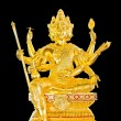 Gold statues of Buddhist deities on black background. — Stock Photo