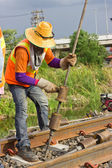 Workers preparing equipment for maintenance of the railway. — Stock Photo