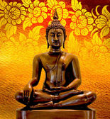 Buddha statue on a gold background. — Stock Photo