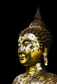 Gold Buddha statue on black background. — Stock Photo