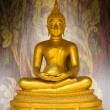 Buddha statue on pattern grunge background. — Stock Photo