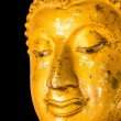 Old golden Buddha statue on black background. — Stock Photo #34878561