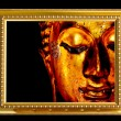 Buddha face in wooden frame. — Stock Photo