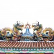 Colorful dragon statue on china temple roof on white. — Stock Photo