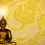Buddha gold statue on golden background patterns Thailand. — Stock Photo #48661529