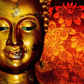Buddha gold statue on red background patterns Thailand. — Stock Photo