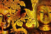 Buddha gold statue on golden background patterns Thailand.  — Stock Photo