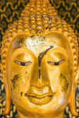 Old gold buddha statue face. — Stock Photo