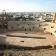 Stock Photo: Amphitheatre with El Djem city skyline