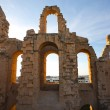 El Djem Amphitheatre arches with sunset — Stock Photo #14132289