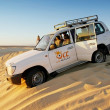 Jeep in desert Sahara — Stock Photo #41292061