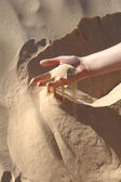 Hand in Sahara sand — Stock Photo