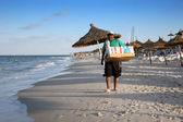 Seller on beach — Stock Photo