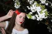 Young woman and cherry blossom — ストック写真