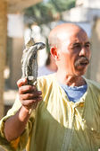 Man holding two desert monitors  in Tozeur Zoo — Stock Photo