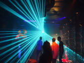 People in disco lightshow — Stock Photo