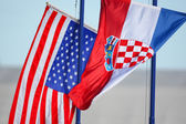 Croatian and American flags waving — Stock Photo
